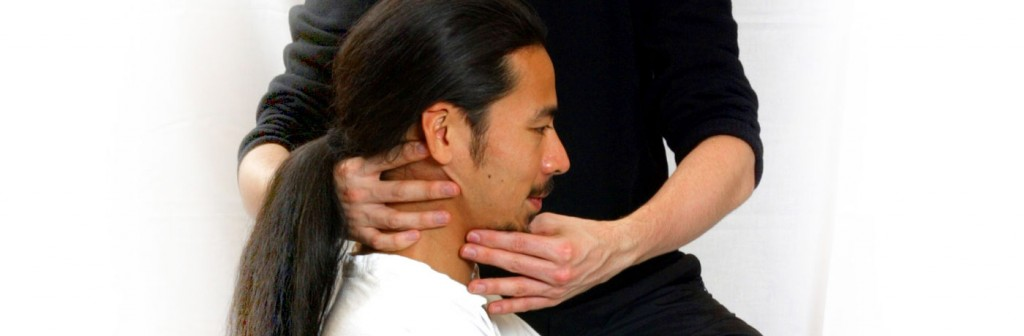 Alexander technique teacher applying positioning to man's head